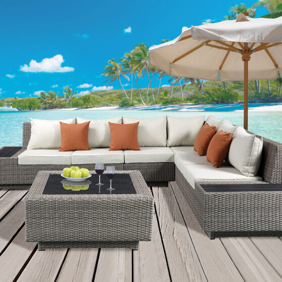 Beige fabric & gray wicker patio sectional & cocktail table