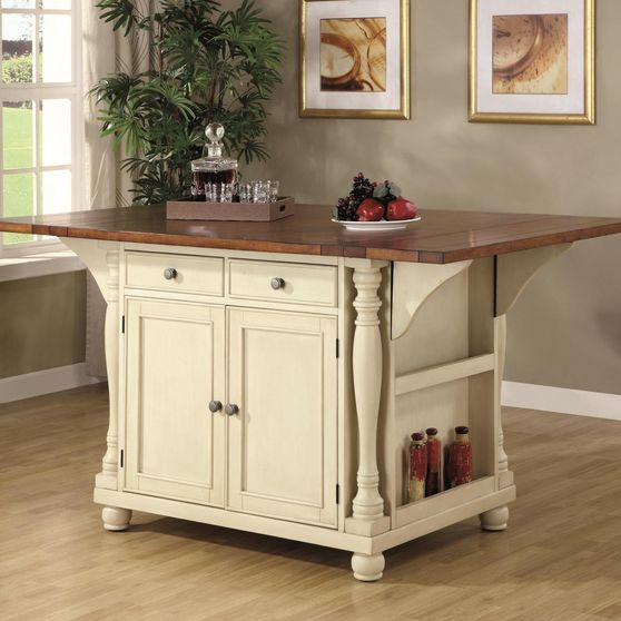 Kitchen island in a buttermilk and cherry finish