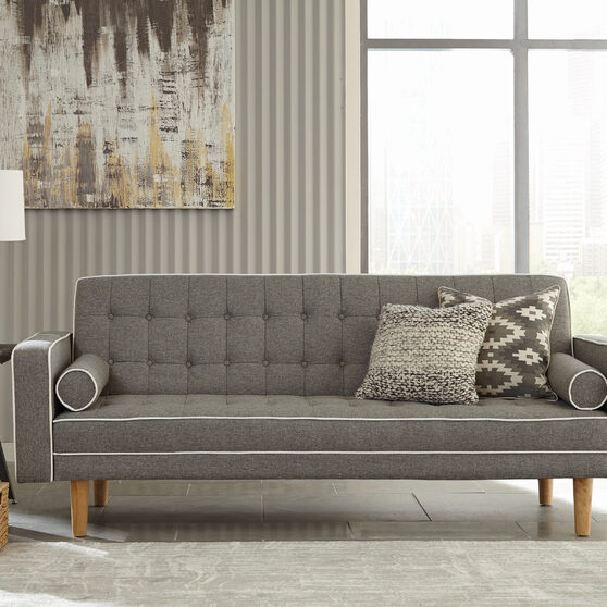 Sofa bed upholstered in gray fabric