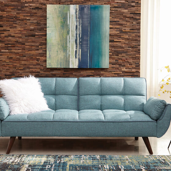 Sofa bed upholstered in a rich turquoise blue fabric