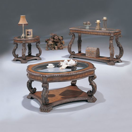 Antique carved base glass coffee table