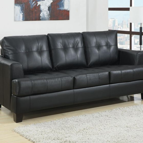 Black leather sofa bed w/ pull-out sleeper