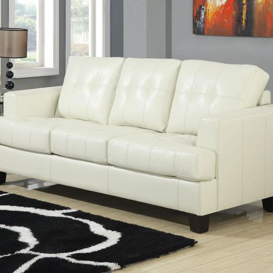 Cream leather sofa bed w/ pull-out sleeper