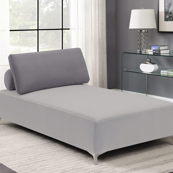Modern styled chaise in a color block palette of gray