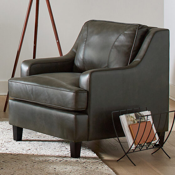 Upholstered in soft breathable gray leatherette chair