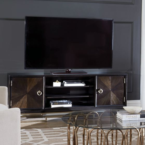 Tv console with rose brass accents