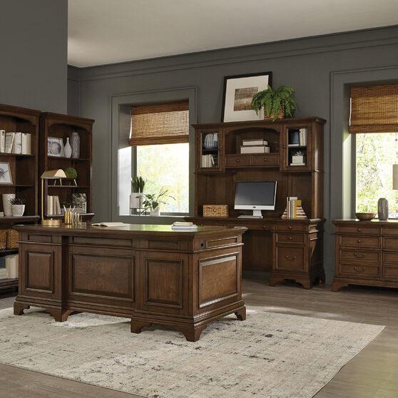 Executive desk finished in burnished oak