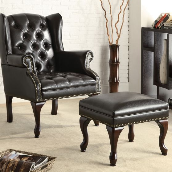 Wing chair with ottoman in dark brown vinyl