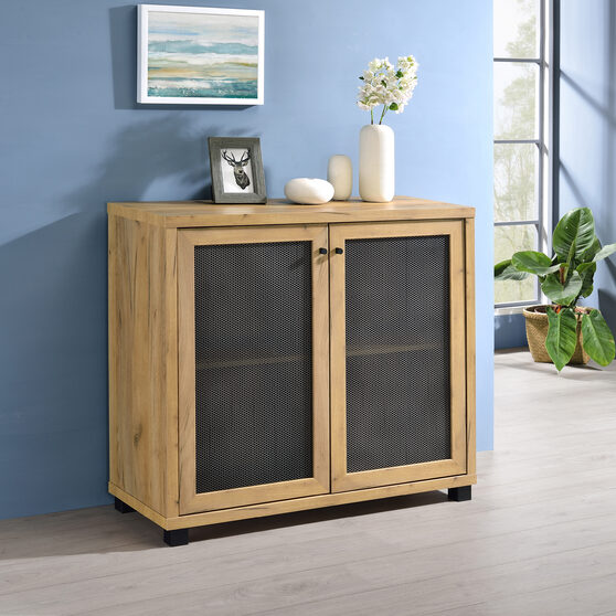 Industrial style accent cabinet finished in golden oak