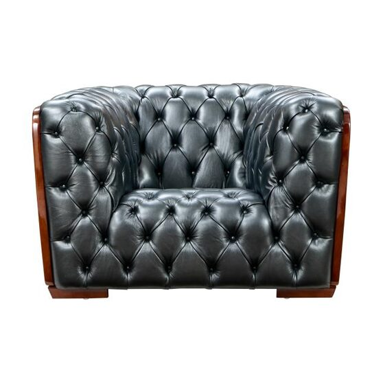 Deeply tufted custom made gray leather chair