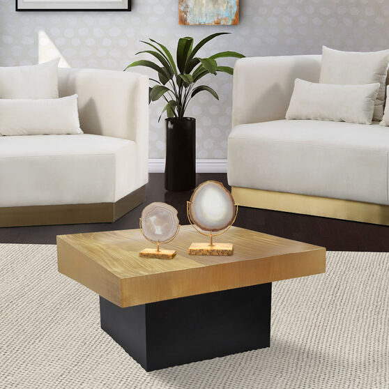 Rich gold / black metal coffee table in glam style