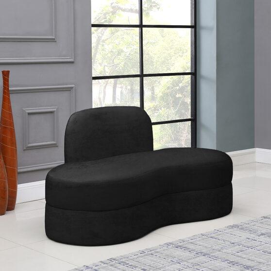 Kidney-shaped lounge style black velvet loveseat