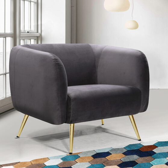 Elegant contemporary velvet / gold legs chair