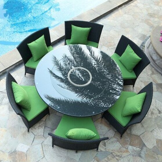 Black 7-piece rattan outdoor dining set with green cushions