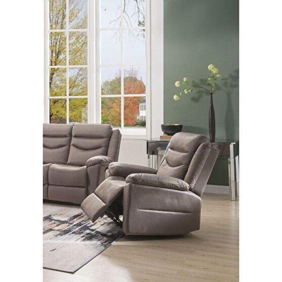 Velvet motion chair in silky brown
