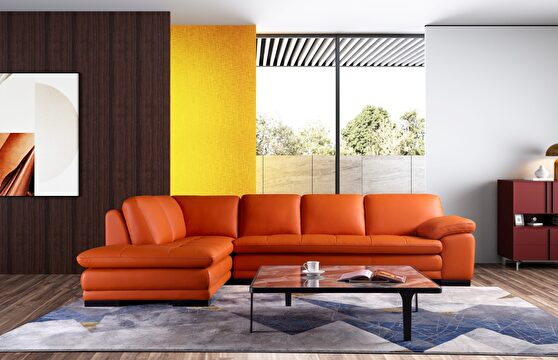Left-facing orange leather low-profile modern sectional