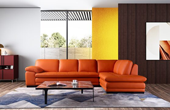 Right-facing orange leather low-profile modern sectional