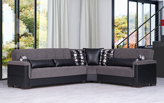 Fully reversible blue fabric / black leather sectional