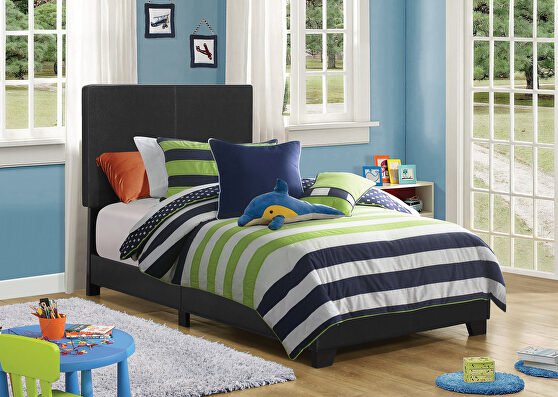 Black faux leather upholstered twin bed
