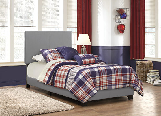 Gray faux leather upholstered twin bed