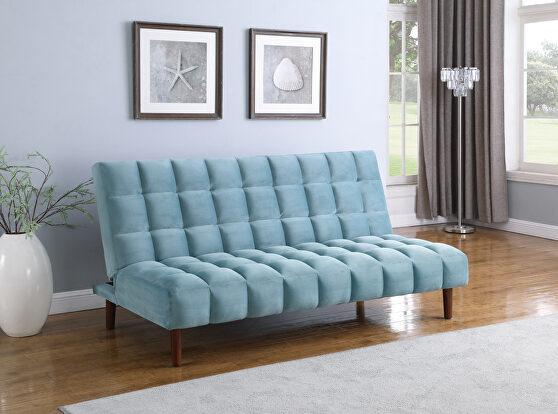 Sofa bed upholstered in durable teal velvet