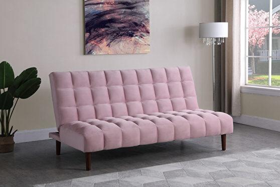 Sofa bed upholstered in durable pink velvet