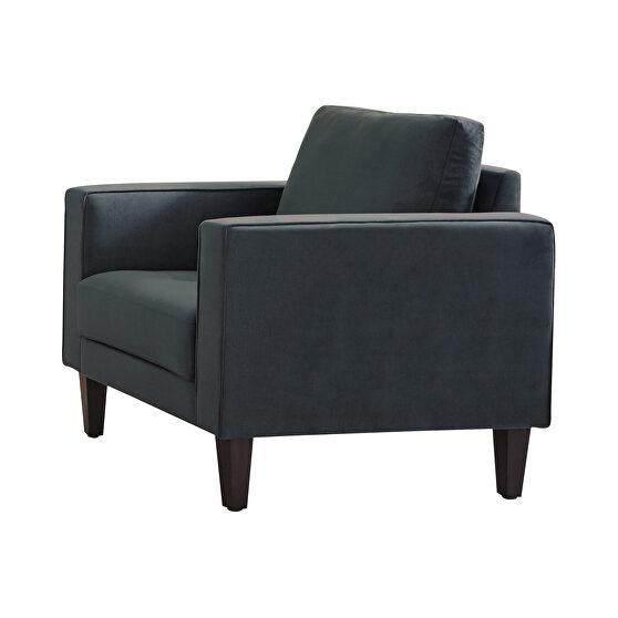 Modern silhouette in dark teal velvet upholstery chair
