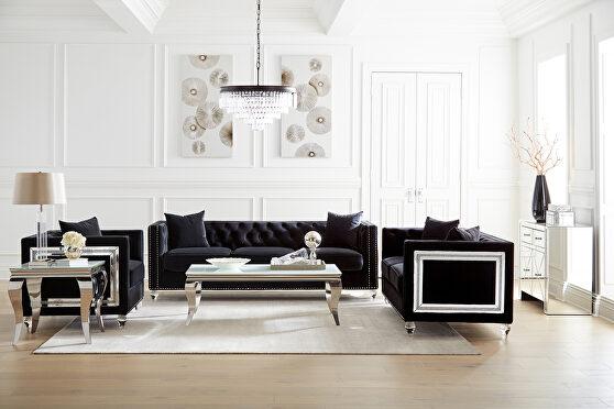 Sofa upholstered in a luxurious black velvet