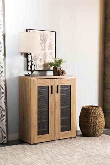 Industrial style storage cabinet in a golden oak finish shoe cabinet
