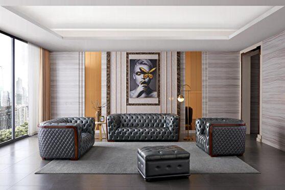 Deeply tufted custom made gray leather sofa
