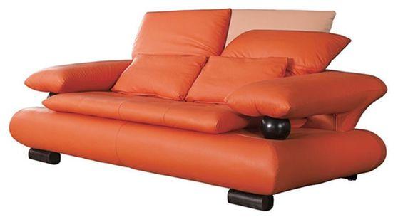 Designer orange leather loveseat w/ ball arm support