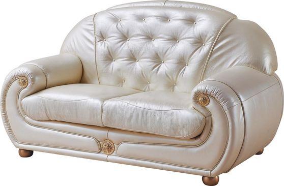 Full beige leather loveseat in classic tufted design
