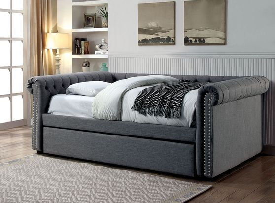 Tufted gray fabric daybed w/ trundle