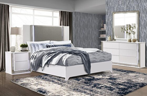 Contemporary white bed w/ light