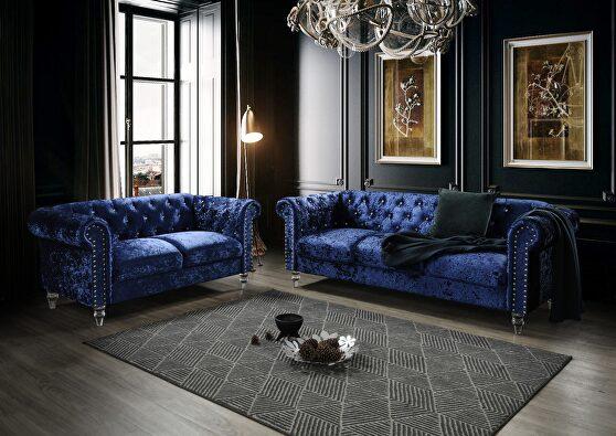 Tufted design low profile glam dark blue velvet sofa