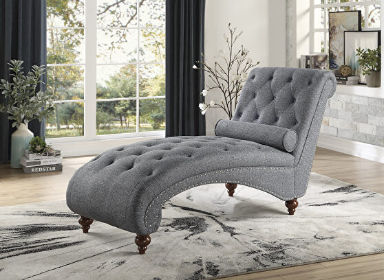 Dark gray textured fabric upholstery chaise with nailhead and pillow