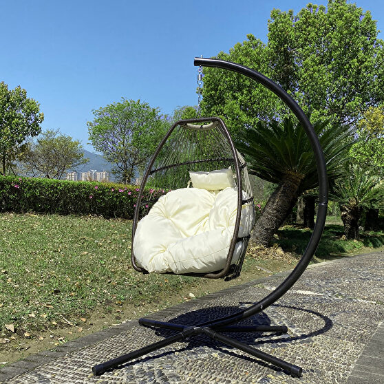 Rattan swing hammock egg chair with beige cushion and pillow