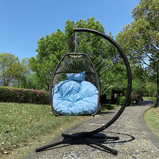 Rattan swing hammock egg chair with blue cushion and pillow