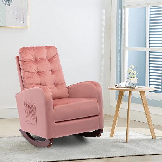 Pink velvet upholstered rocking chair