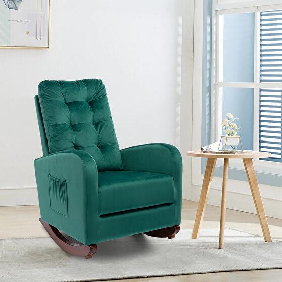 Green velvet upholstered rocking chair