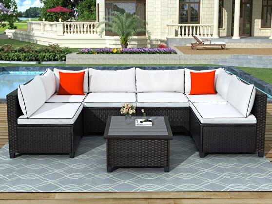 U-shape sectional outdoor furniture set w/ beige cushions