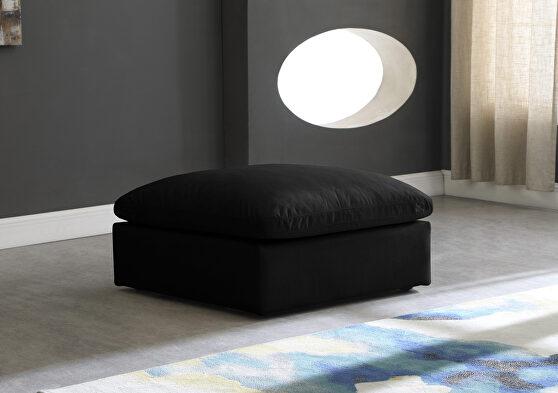 Modular black velvet ottoman