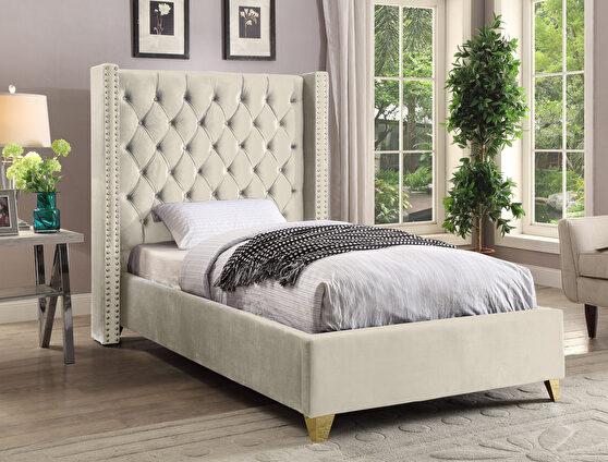 Modern gold legs / nailheads cream velvet twin bed