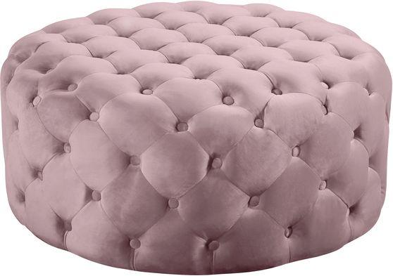 Pink velvet round tufted ottoman