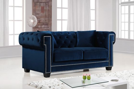 Navy fabric tufted seat & back loveseat