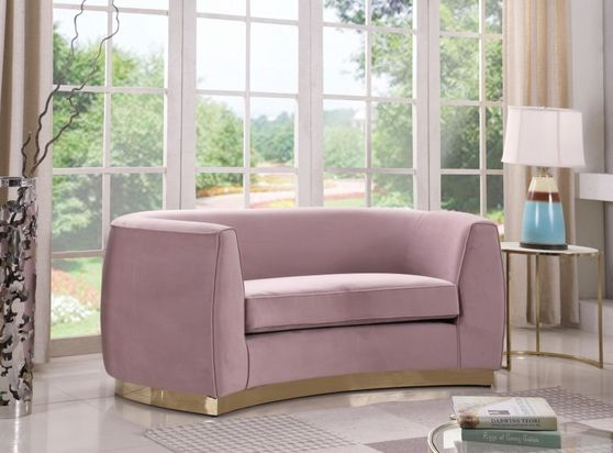 Pink velvet contemporary loveseat  w/ curved base