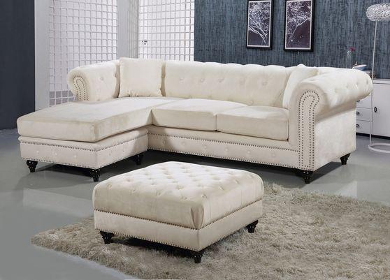 Reversible sectional sofa in cream velvet fabric