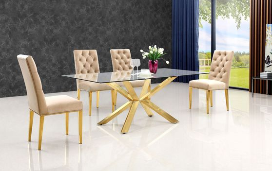 Rich gold stainless steel base / glass top table