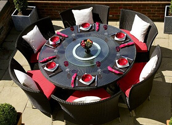 Black 7-piece rattan outdoor dining set with red and white cushions