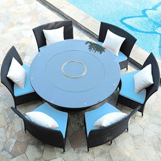Black 7-piece rattan outdoor dining set with sky blue and white cushions